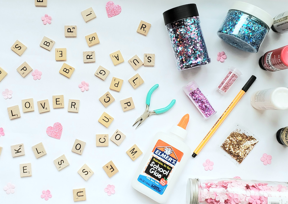 Flat lay of crafting supplies, and glitter for Mood 13